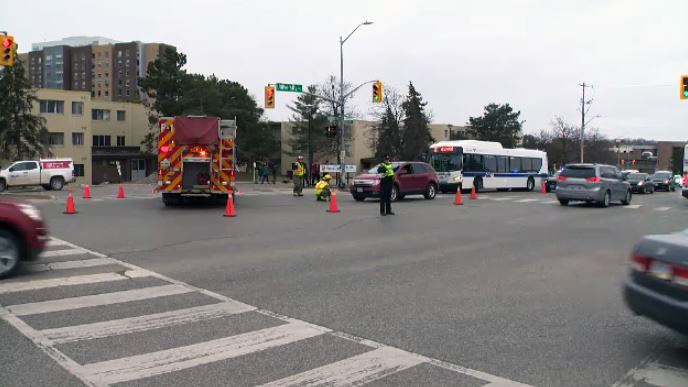 Emergency crews work at the scene after a pedestrian was hit by a vehicle at University Avenue and Phillip Street in Waterloo on Tuesday, April 24, 2018.