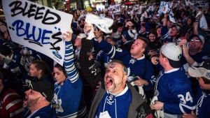 Fans react during a third period goal at a Playoff Tailgate Party in Maple Leaf Square during game six of the NHL Stanley Cup playoff series between the Toronto Maple Leafs and the Washington Capitals in Toronto on Sunday, April 23, 2017. THE CANADIAN PRESS/Aaron Vincent Elkaim