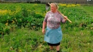 Dolores Leis stands in a field on her farm in Galicia, in northern Spain, Thursday April 19, 2018. (Paula Vazquez via AP)