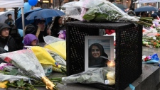 A photo of Anne Marie D'Amico is left at a vigil on Yonge Street in Toronto, Tuesday, April 24, 2018. Ten people were killed and 14 were injured in Monday's deadly attack in which a van struck pedestrians in northern Toronto. THE CANADIAN PRESS/Galit Rodan