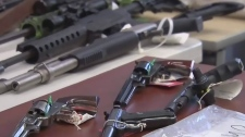 Guns, drugs, cash seized in smuggling probe