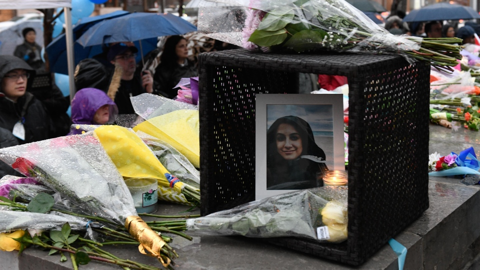 A photo of Anne Marie D'Amico is left at a vigil on Yonge Street in Toronto, Tuesday, April 24, 2018. THE CANADIAN PRESS/Galit Rodan