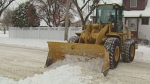 Plow clearing snow from the streets of Winnipeg.