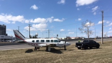 The plane was pulled on to the grassy shoulder just before 3:00 p.m. on Wednesday.