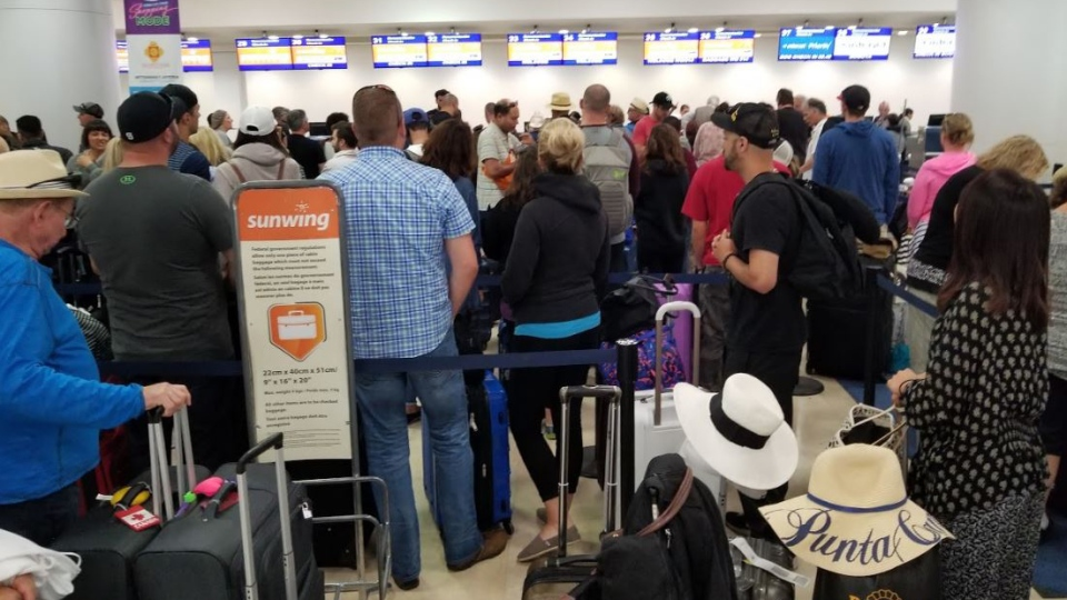 Sunwing passengers on flight WG 514, which was delayed more than 29 hours, wait inside an airport in Cancun, Mexico. (Source: Judy Wu)