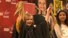 Students lose locks for cancer research