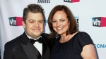 In this Jan. 12, 2012 file photo, comedian Patton Oswalt, left, and his wife Michelle McNamara arrive at the 17th annual Critics' Choice Movie Awards in Los Angeles. (AP Photo/Matt Sayles, File)