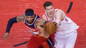 Toronto Raptors centre Jakob Poeltl (42) battles for the ball against Washington Wizards forward Mike Scott (30) during second half game five of round one, NBA playoff basketball action in Toronto on Wednesday, April 25, 2018. THE CANADIAN PRESS/Nathan Denette