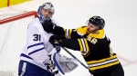 Boston Bruins center David Krejci (46) checks Toronto Maple Leafs goaltender Frederik Andersen (31) during the second period of Game 7 of an NHL hockey first-round playoff series in Boston, Wednesday, April 25, 2018. (AP Photo/Charles Krupa)