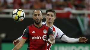 Toronto FC's Victor Vazquez, front, fights for the ball with Chivas' Isaac Brizuela during the CONCACAF Champions League final soccer match in Guadalajara, Mexico, Wednesday, April, 25, 2018. (AP Photo/Eduardo Verdugo)