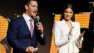 John Cena, left, a cast member in the upcoming film 'Bumblebee,' addresses the audience as fellow cast member Hailee Steinfeld looks on during the Paramount Pictures presentation at CinemaCon 2018, the official convention of the National Association of Theatre Owners, at Caesars Palace on Wednesday, April 25, 2018, in Las Vegas. (Photo by Chris Pizzello/Invision/AP)