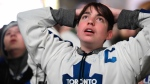 Matteo Morano, 16, reacts as he watches the Toronto Maple Leafs play the Boston Bruins on a large TV screen at Maple Leaf Square in Toronto, Wednesday, April 25, 2018. The Bruins stormed back to defeat the Toronto Maple Leafs 7-4 on Wednesday in Game 7 to advance to the second round of the Stanley Cup playoffs. THE CANADIAN PRESS/Galit Rodan