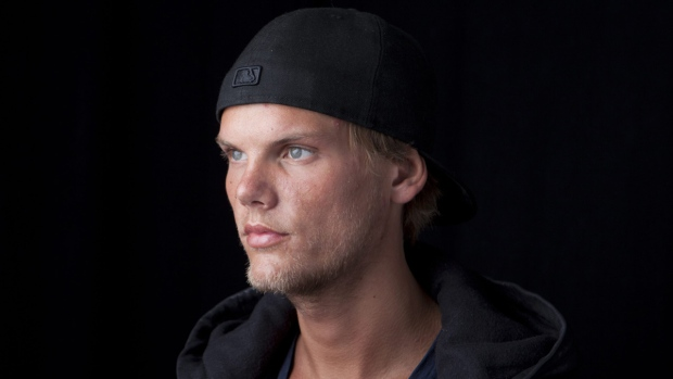 Avicii poses for a portrait in New York, on Aug. 30, 2013. (Amy Sussman / Invision / AP)
