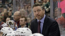Colorado Avalanche head coach Patrick Roy watches from the bench during the third period of an NHL hockey game against the Minnesota Wild in St. Paul, Minn. Feb. 7, 2015. THE CANADIAN PRESS/AP, Ann Heisenfelt