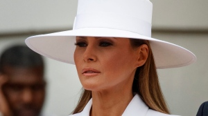 First lady Melania Trump waits with President Donald Trump to greet French President Emmanuel Macron and his wife Brigitte Macron during a State Arrival Ceremony on the South Lawn of the White House in Washington, Tuesday, April 24, 2018. (AP Photo/Carolyn Kaster)