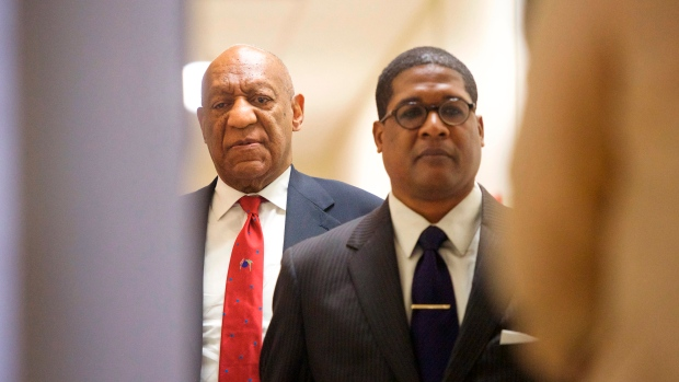 Actor and comedian Bill Cosby, left, reacts after being notified a verdict was in in his sexual assault retrial, Thursday, April, 26, 2018, at the Montgomery County Courthouse in Norristown, Pa. (Mark Makela/Pool Photo via AP)
