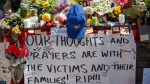 Tributes are seen on a memorial at Yonge St. and Finch Ave. in Toronto on Thursday, April 26, 2018 for the victims of Monday's deadly van attack. THE CANADIAN PRESS/Cole Burston