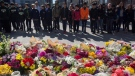Flowers line a memorial at Mel Lastman Square in Toronto on Thursday, April 26, 2018 for the victims of Monday's deadly van attack. THE CANADIAN PRESS/Cole Burston