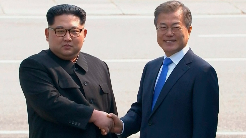 North Korean leader Kim Jong Un, left, shakes hands with South Korean President Moon Jae-in, in Panmunjom, on April 27, 2018. (Korea Broadcasting System via AP)
