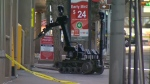 The Tactical Team's bomb inspection robot was deployed to investigate a suspicious package at 4 Avenue S.E.