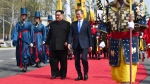 North Korean leader Kim Jong Un, left, and South Korean President Moon Jae-in walk together at the border village of Panmunjom in the Demilitarized Zone Friday, April 27, 2018. (Korea Summit Press Pool via AP)