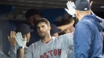 Boston Red Sox's J.D. Martinez reacts after hitting a three run home run during fifth inning AL baseball action against the Toronto Blue Jays in Toronto on Thursday, April 26, 2018. THE CANADIAN PRESS/Nathan Denette