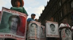 Relatives of 43 missing college students from Mexico's Guerrero state mark the 43rd month since their disappearances, with a march in Mexico City on Thursday, April 26, 2018. (AP Photo/Marco Ugarte)