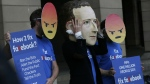 A protester wearing a mask with the face of Facebook founder Mark Zuckerberg, in between men wearing angry face emoji masks, during a protest against Facebook outside Portcullis in London as the Chief Technical Officer of Facebook Mike Schroepfer is due to give evidence on the companies use of data from its customers in front of a Parliamentary Select Committee on on Thursday, April 26, 2018. (AP Photo/Alastair Grant)