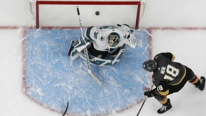 Vegas Golden Knights left wing James Neal scores on San Jose Sharks goaltender Aaron Dell (30) during the third period of Game 1 of an NHL hockey second-round playoff series in Las Vegas on Thursday, April 26, 2018. (AP Photo/John Locher)