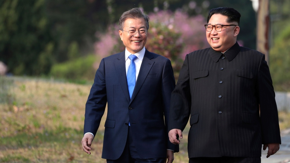 North Korean leader Kim Jong Un, right, and South Korean President Moon Jae-in walk together at the border village of Panmunjom in the Demilitarized Zone, South Korea, Friday, April 27, 2018. (Korea Summit Press Pool via AP)