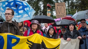 Religious leaders joined other demonstrators outside Kinder Morgan&#39;s facility in Burnaby, B.C. in protest of the Trans Mountain pipeline expansion on Saturday, April 28, 2018.  <br><br> People listen as religious leaders and more than 100 members of diverse faith communities participate in a protest against the expansion of the Kinder Morgan Trans Mountain Pipeline, at the company&#39;s facility in Burnaby, B.C., on Saturday, April 28, 2018. THE CANADIAN PRESS/Darryl Dyck