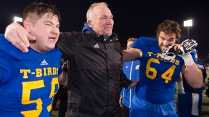 UBC Thunderbirds head coach Blake Nill, celebrates with players Levi Hua, left, and Dakoda Shepley after winning against the Montreal Carabins, Saturday, November 28, 2015 in Quebec City. (THE CANADIAN PRESS/Jacques Boissinot)