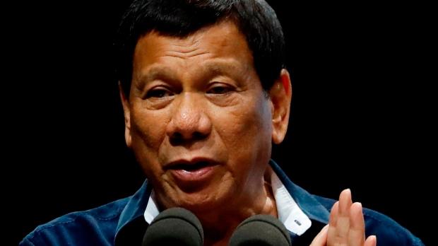 In this Saturday, April 28, 2018, file photo, Philippine President Rodrigo Duterte addresses the Filipino community in Singapore. (AP Photo/Yong Teck Lim, File)