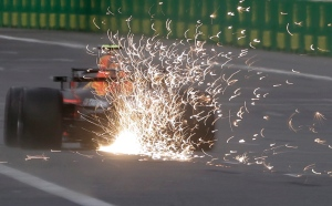 In this picture taken with a slow shutter speed, Red Bull driver Max Verstappen of the Netherlands leaves a trail of sparks during the qualifying session at the Baku Formula One city circuit, in Baku, Azerbaijan, Saturday, April 28, 2018. (AP Photo/Luca Bruno)