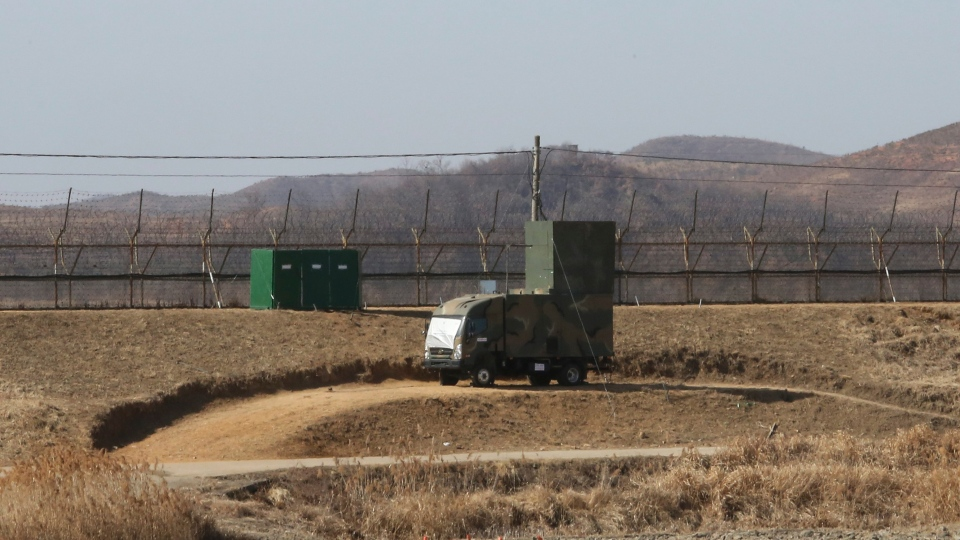 In this Feb. 15, 2018 photo, a South Korean military vehicle with loudspeakers is seen in front of the barbed-wire fence in Paju, near the border with North Korea. (AP Photo/Ahn Young-joon)