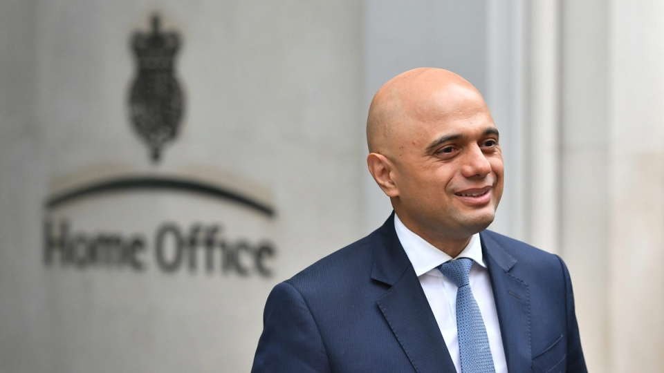 Home Secretary Sajid Javid poses for photographers outside the Home Office in Westminster, London, on April 30, 2018.  (Dominic Lipinski/PA via AP)
