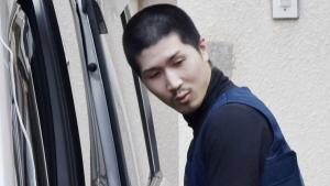 Tatsuma Hirao being transferred to a police station in Hiroshima, on April 30, 2018. (Tsuyoshi Ueda/Kyodo News via AP)