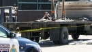 Police investigate after a man was killed by a falling slab of granite at a business on Manitou Drive in Kitchener on Monday, April 30, 2018.
