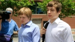 Tim Foley, 20, left, and his brother Alex, 16, leave federal court after a bail hearing for their parents, Donald Heathfield and Tracey Lee Ann Foley, in Boston, on Thursday, July 1, 2010. (AP Photo/Elise Amendola)