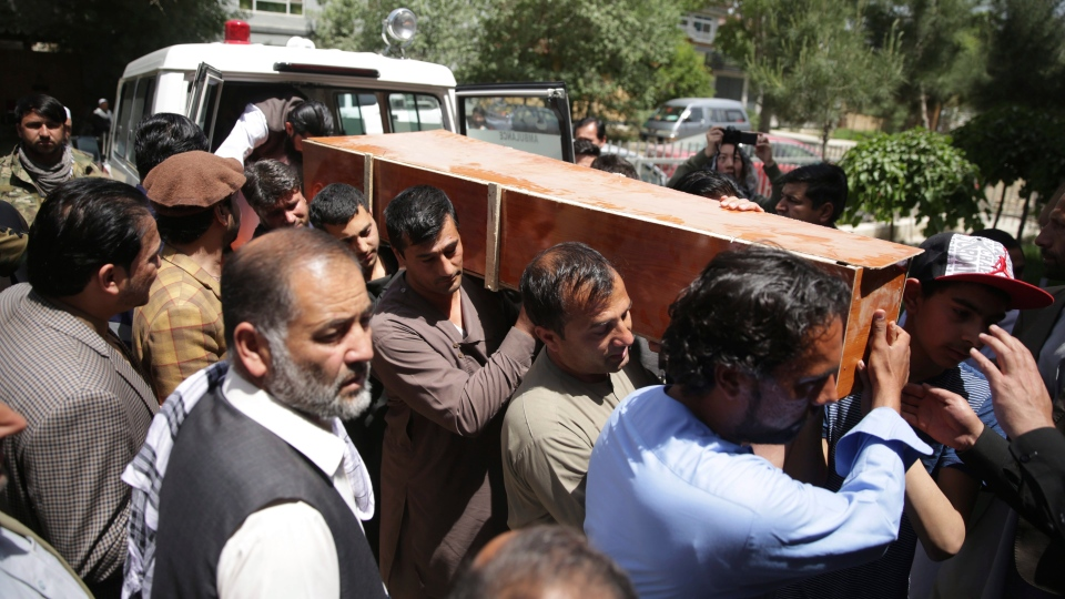 Relatives, colleagues and friends carry the coffin of AFP chief photographer Shah Marai in Gul Dara district, Afghanistan on Monday, April 30, 2018. Marai died in a suicide blast in Kabul. (AP Photo/Rahmat Gul)