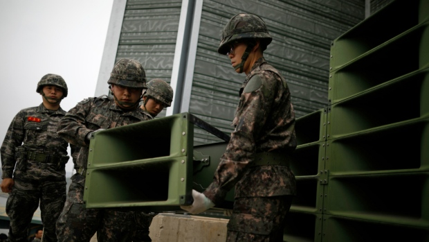 South Korean soldiers dismantling loudspeakers