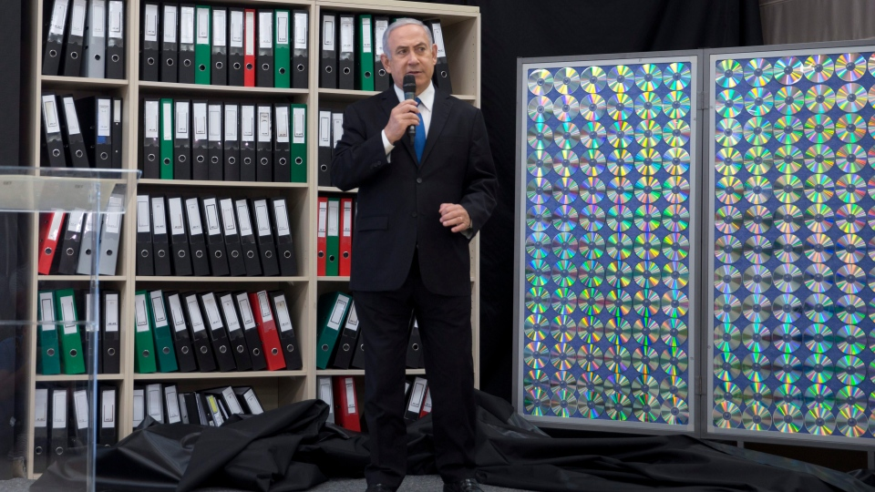 Israeli Prime Minister Benjamin Netanyahu presents material on Iranian nuclear weapons development during a press conference in in Tel Aviv, Israel, Monday, April 30, 2018. (AP Photo/Sebastian Scheiner)