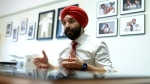 Minister of Innovation, Science and Economic Development Navdeep Bains participates in an interview with the Canadian Press in his Parliament Hill office, in Ottawa on Tuesday, May 1, 2018. THE CANADIAN PRESS/Justin Tang