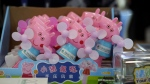 In this April 27, 2018 photo, hand cranked fans with Peppa Pig theme are seen during the Global Mobile Internet Conference (GMIC) in Beijing, China. (AP Photo/Ng Han Guan)