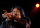 """In a photo photo James Brown sings """"Living in America"""" during his three-hour concert at the Wiltern Theater in Los Angeles, Ca., on June 10, 1991. (AP Photo/Kevork Djansezian)"""