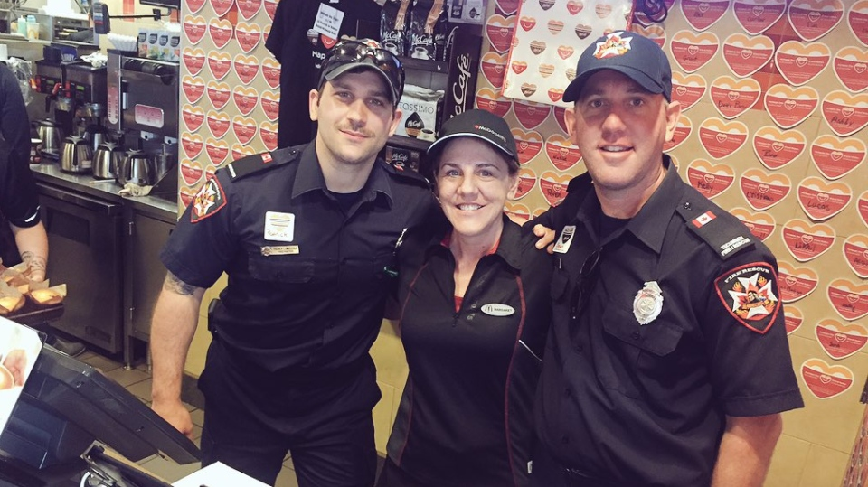 Tecumseh firefighters help out behind the counter for McHappy Day in Tecumseh, Ont., on Wednesday, May 2, 2018. (Sacha Long / CTV Windsor)