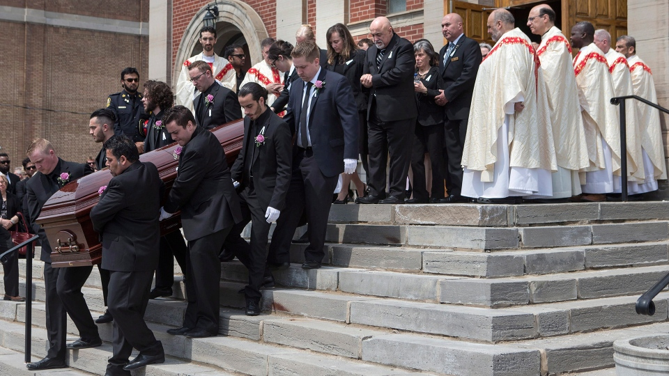 Anne Marie D'Amico's casket is followed by family members after her funeral service in Toronto on Wednesday, May 2, 2018. (Chris Young / THE CANADIAN PRESS)