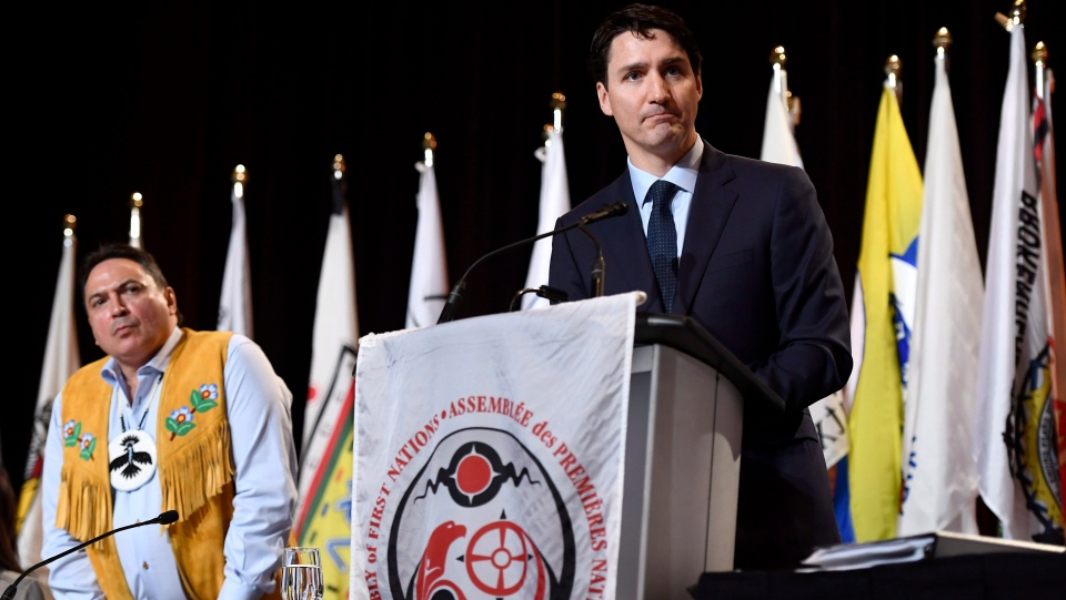 Prime Minister Justin Trudeau and AFN National Chief Perry Bellegarde listen to a question after the Prime Minister's address at the Assembly of First Nations Special Chiefs Assembly, in Gatineau, Que., on Wednesday, May 2, 2018. THE CANADIAN PRESS/Justin Tang