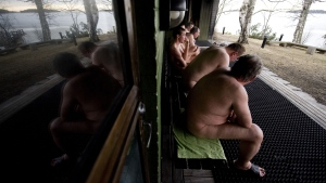 Finnish men cool off during a day at a public sauna in Helsinki. (© Jonathan NACKSTRAND / AFP)