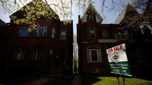 "A ""For Sale"" sign sits in front of a house in Toronto on April 20, 2010. THE CANADIAN PRESS/Darren Calabrese"